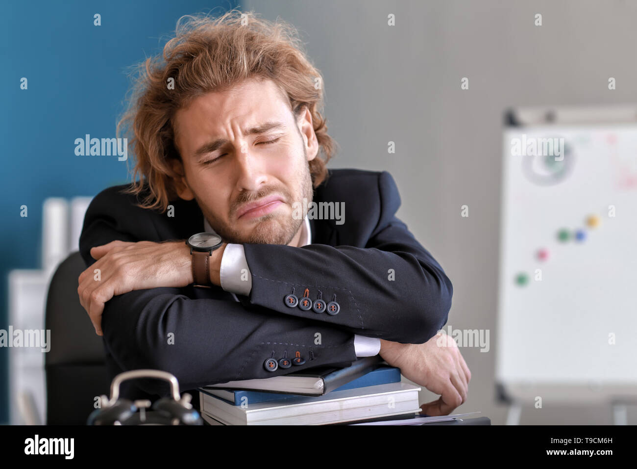 Stressed businessman missing deadlines in office - Stock Image