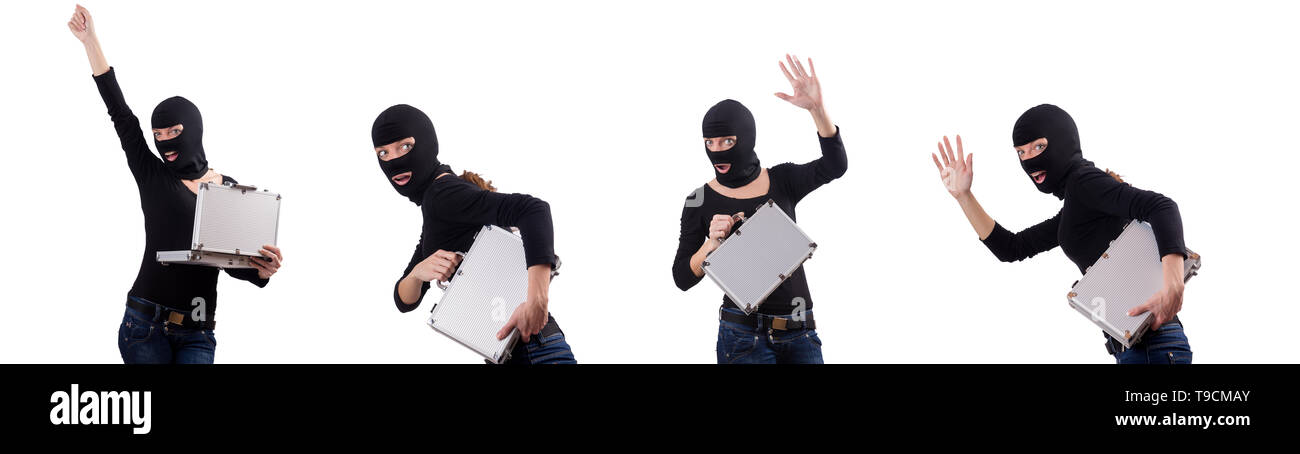 Industrial espionage concept with person in balaclava - Stock Image