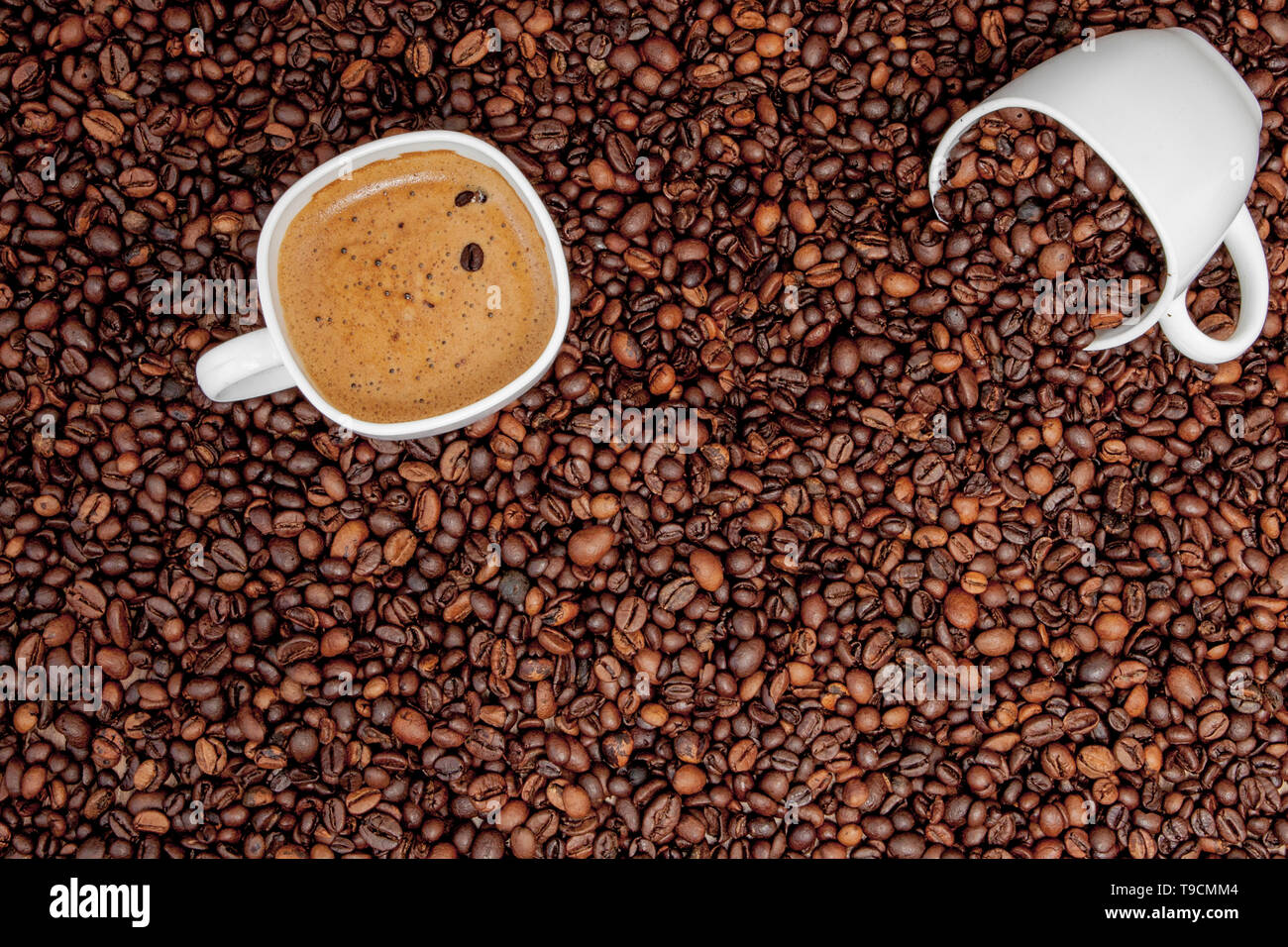 Coffee cup on wooden table. View from top. - Stock Image