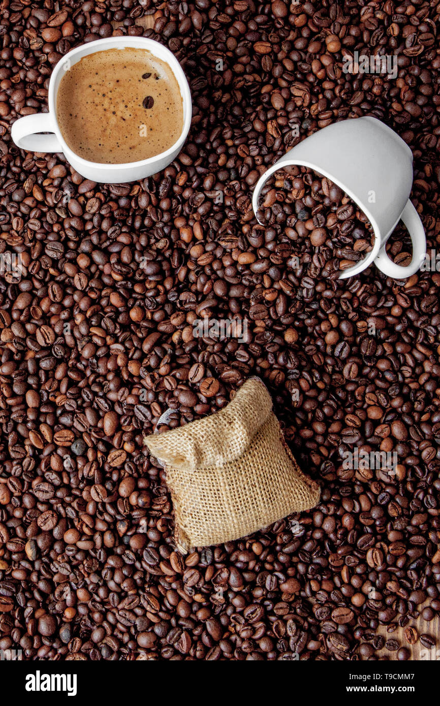 Coffee cup with coffee bag on wooden table. View from top. - Stock Image