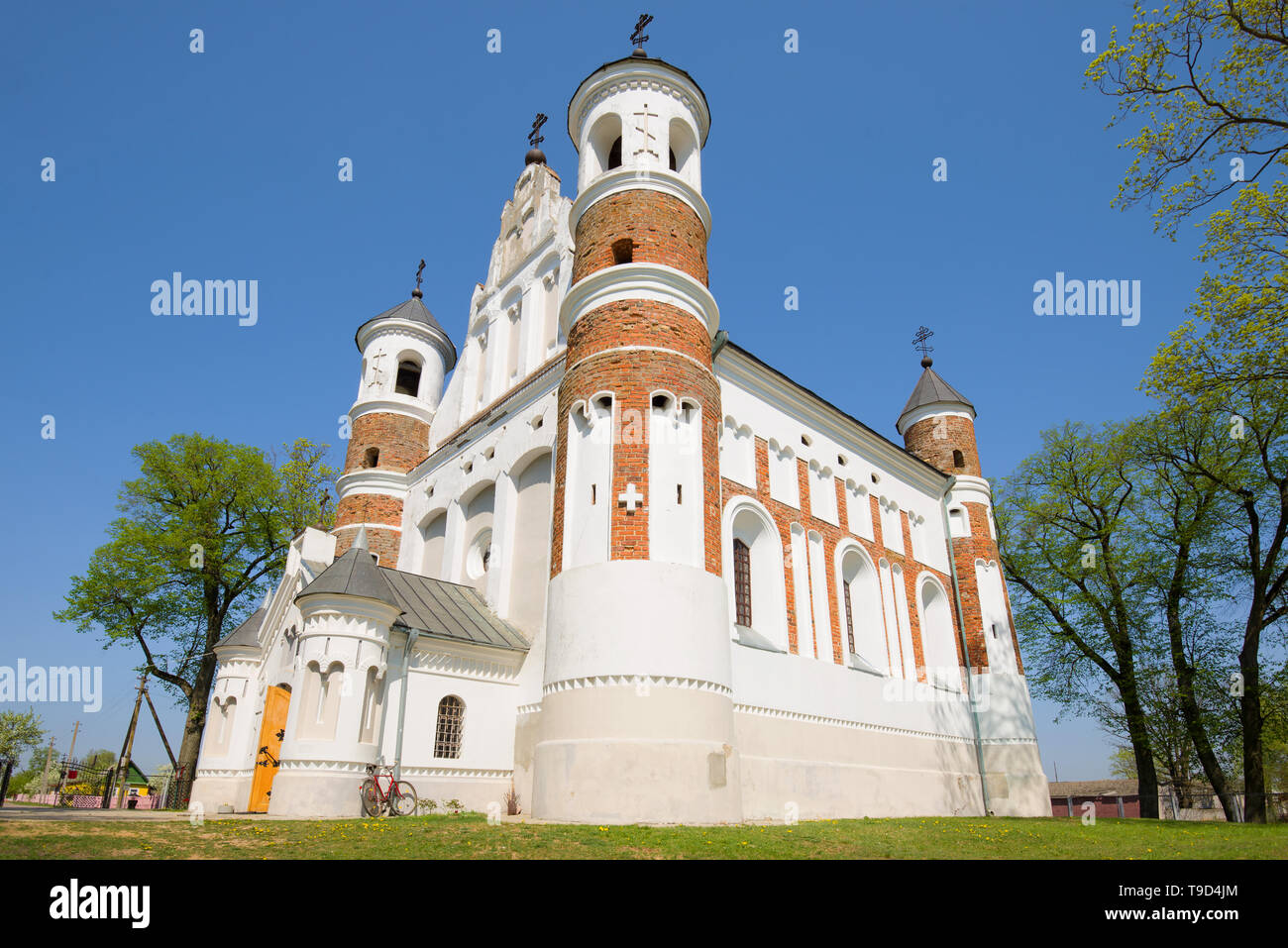 The fortified church of the Nativity of the Virgin Mary close up on a sunny April day. Murovanka, Belarus - Stock Image
