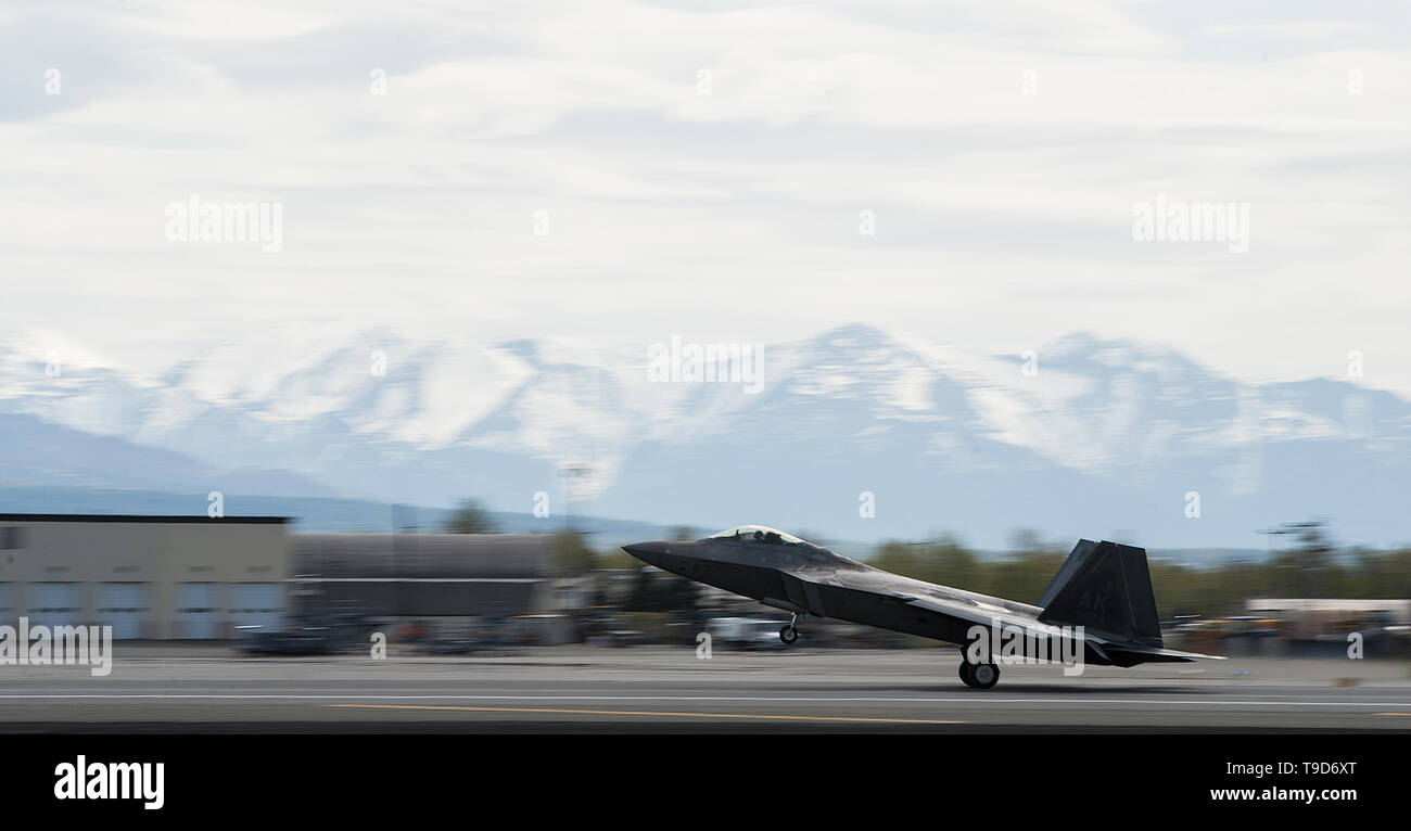 A U.S. Air Force F-22 Raptor lands during Northern Edge, May 14, 2019, at Joint Base Elmendorf-Richardson, Alaska. Northern Edge provides effective, capabilities-centered joint forces, ready for deployment world-wide and enables real-world proficiency in detection, identification and tracking of units at sea, in the air, and on land and respond to multiple crises in the Indo-Pacific region. (U.S. Air Force photo by Master Sgt. Nathan Lipscomb) - Stock Image