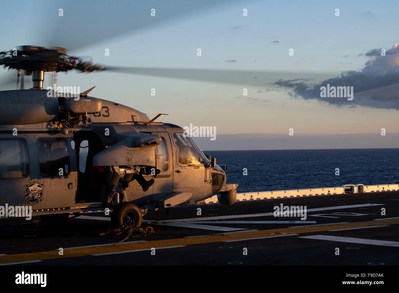 190516-N-IQ884-2088  PEARL HARBOR (May 16, 2019) An MH-60S Sea Hawk assigned to Helicopter Sea Combat Squadron (HSC) 21 operates its rotors during ground turns operations on the flight deck of amphibious assault ship USS Boxer (LHD 4). Sailors and Marines of the Boxer Amphibious Ready Group (ARG) and 11th Marine Expeditionary Unit (MEU) are embarked on USS Boxer (LHD 4) on a regularly-scheduled deployment. (U.S. Navy photo by Mass Communication Specialist 2nd Class Dale M. Hopkins) - Stock Image