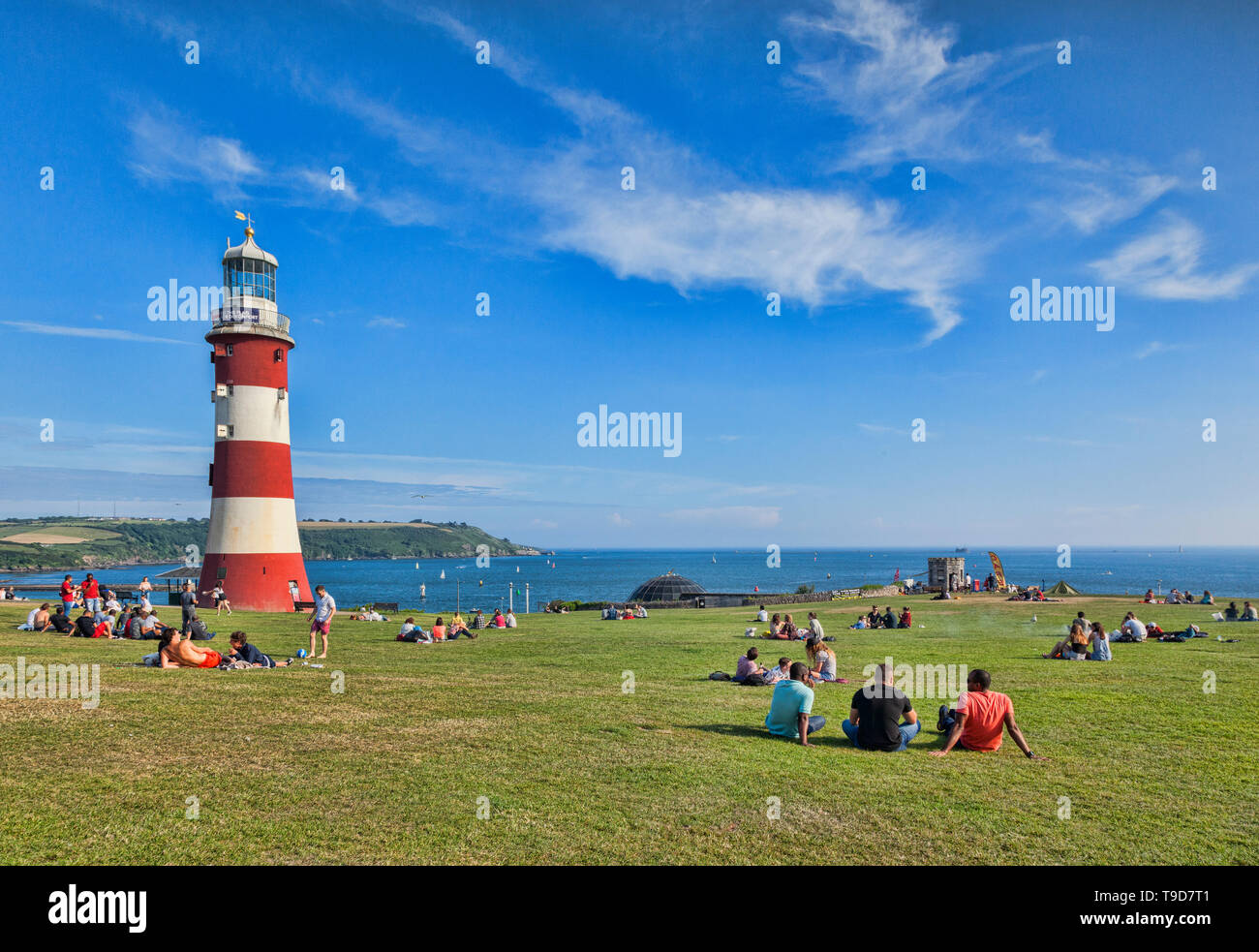 9 June 2018: Plymouth, Devon UK - Plymouth Hoe on a beautiful spring evening, with the third Eddystone Lighthouse, now known as Smeaton's Tower, reloc Stock Photo