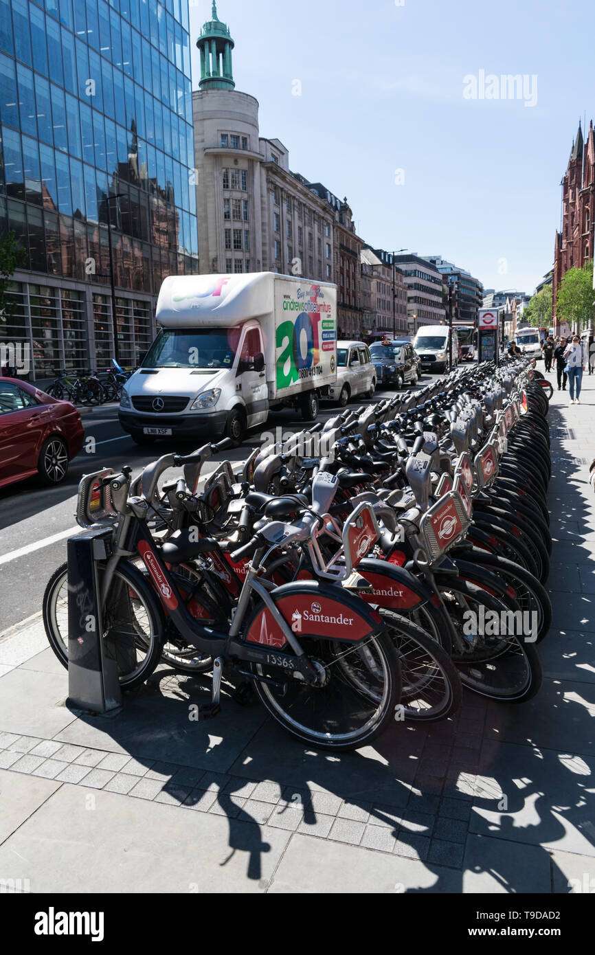 LONDON, UNITED KINGDOM - May 14, 2019: London public bicycles lined up along the side of the street in the City of London. Stock Photo