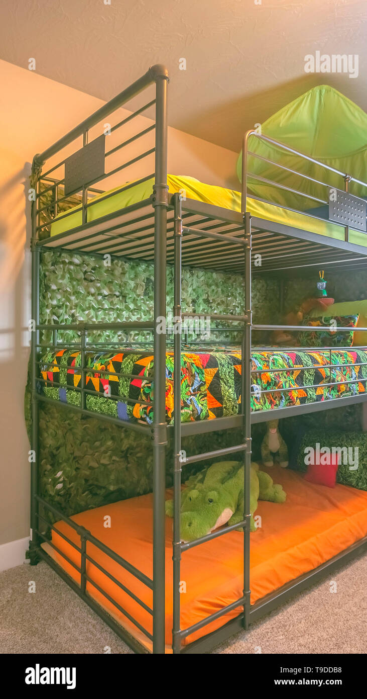 Vertical Cozy Room Interior With A Colorful Triple Bunk Bed For Children Stock Photo Alamy