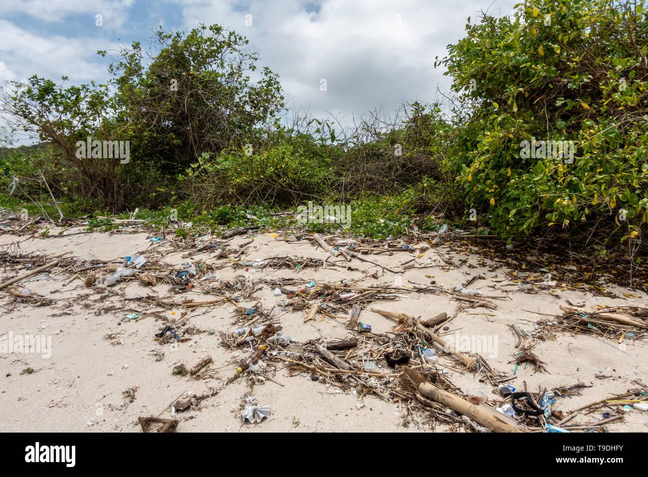 Lomok, Indonesia - February  2 2019 Plastic waste on a deserted beach in Lombok near Kuta, Indonesia - Stock Image