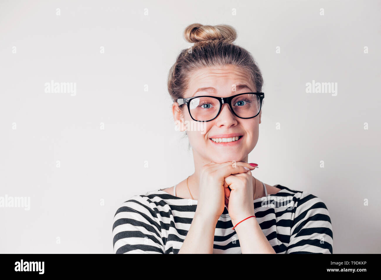 1177cdc4fd96 Beautiful smiling woman with clean skin, natural makeup, white teeth  wearing black-rimmed
