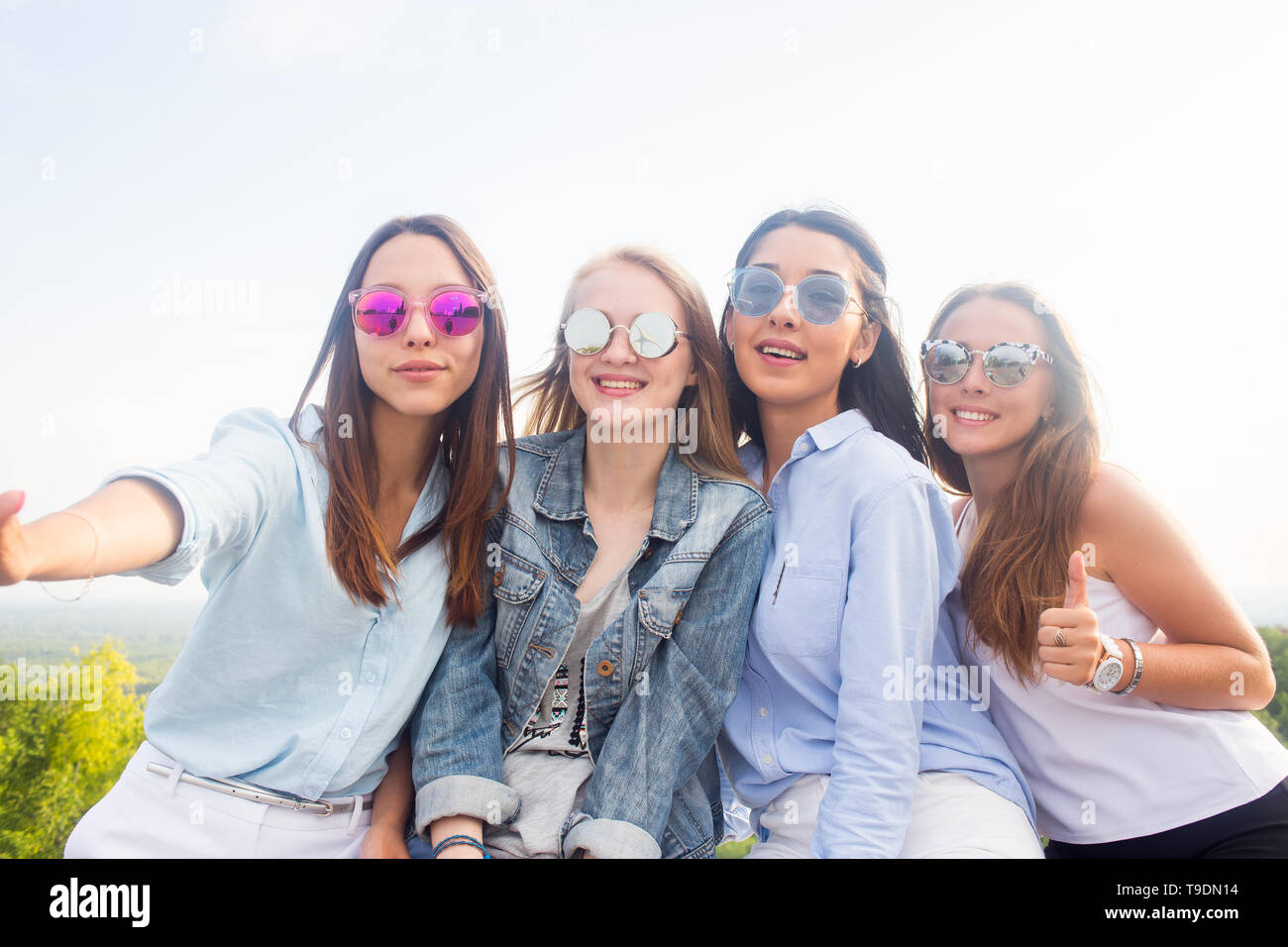 Best Friends Take Selfies While Walking In The Park Four Beautiful Women Wearing Sunglasses Are Having A Good Day Four Beautiful Young Student Girls Stock Photo Alamy