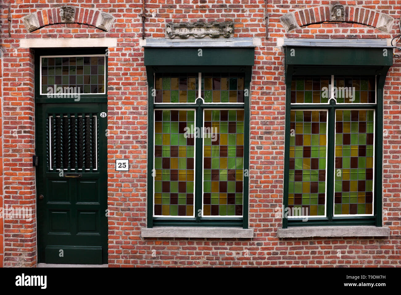 House with stained glass windows in Bruges, Belgium - Stock Image