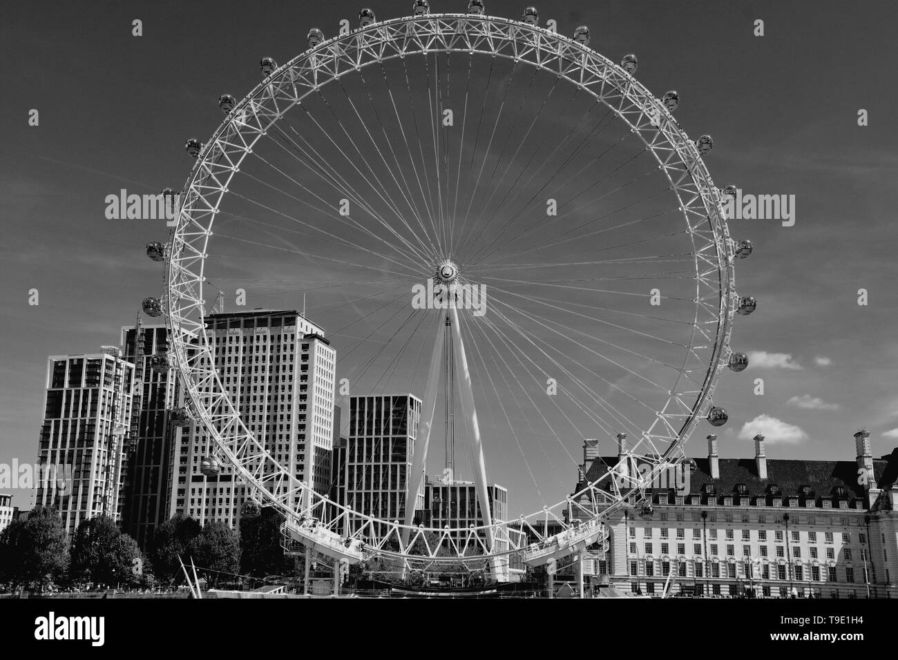 The London Eye on the South Bank of the River Thames at night in London, England - Stock Image