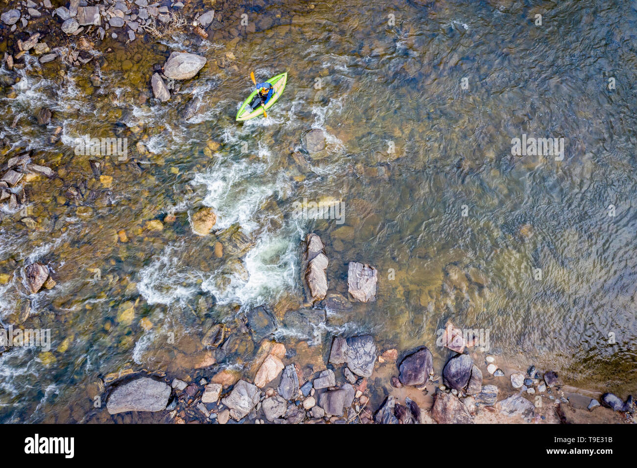 inflatable whitewater kayak below rapid on a mountain river (Poudre River in Colorado), aerial perspective - Stock Image