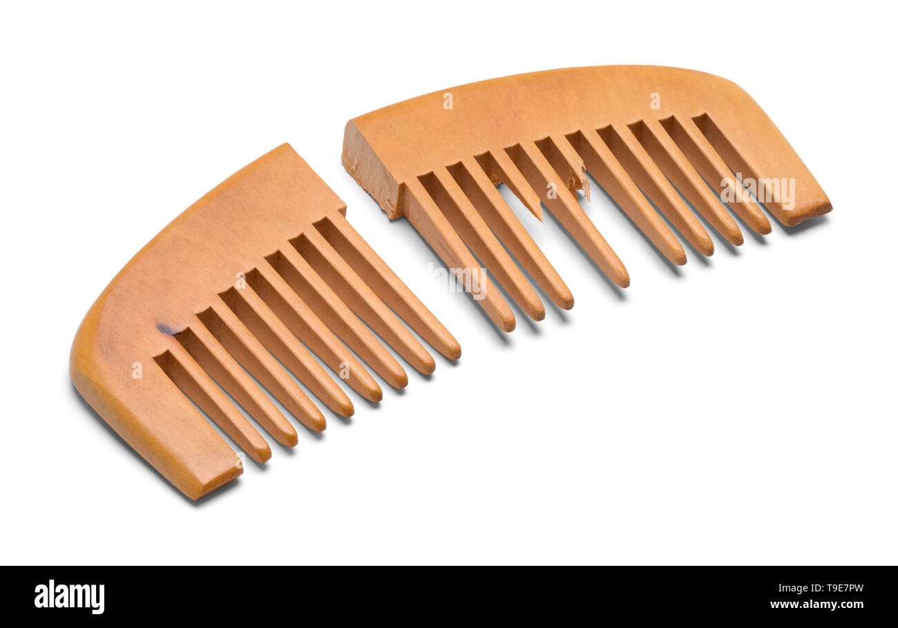 Broken Wood Hand Comb Isolated on White Background. Stock Photo