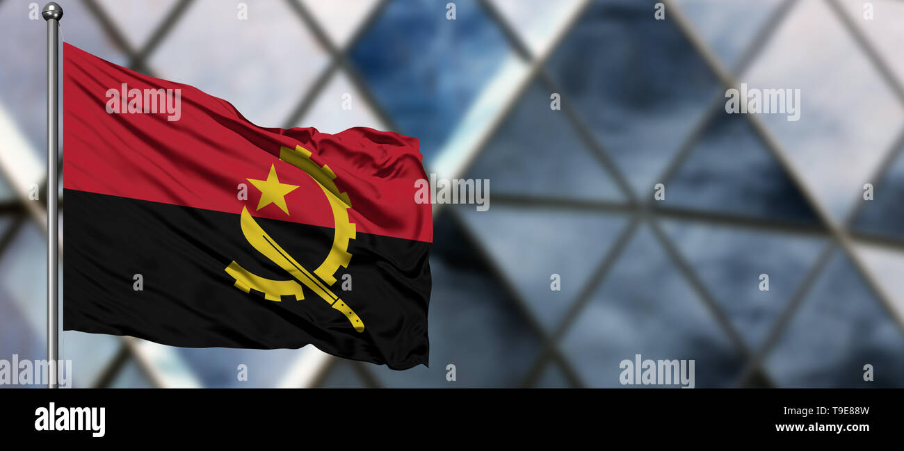 Angola flag waving in the wind against blurred modern building. Business concept. National cooperation theme. - Stock Image