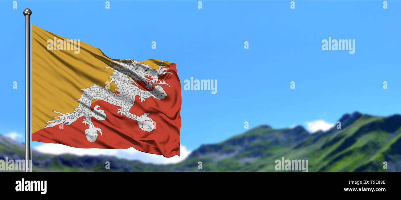Bhutan flag waving in the blue sky with green fields at mountain peak background. Nature theme. - Stock Image