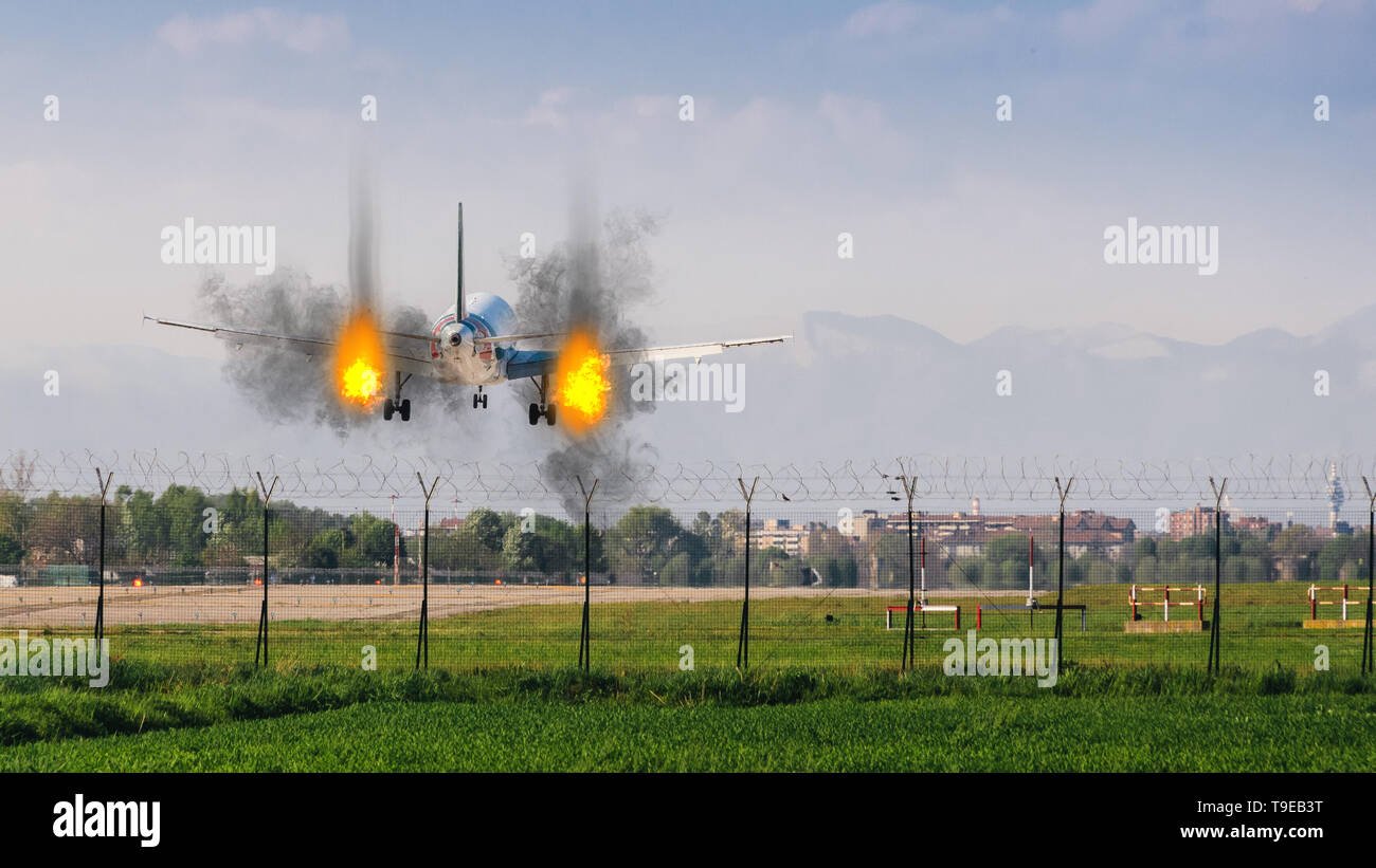 Twin engines on fire emergency landing concept at airport with copy space - Stock Image