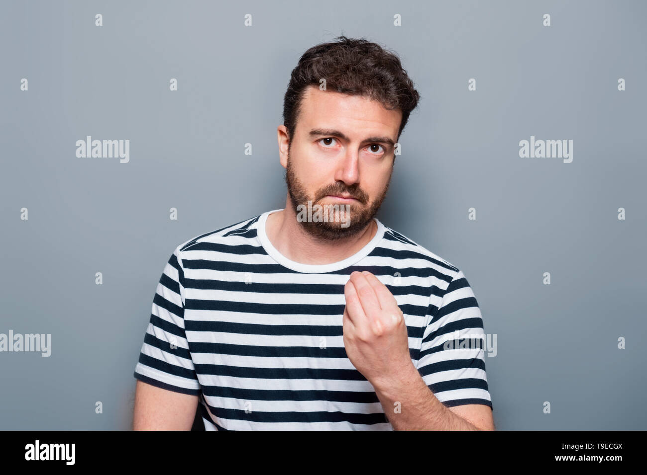 Studio portrait of doubtful caucasian male - Stock Image