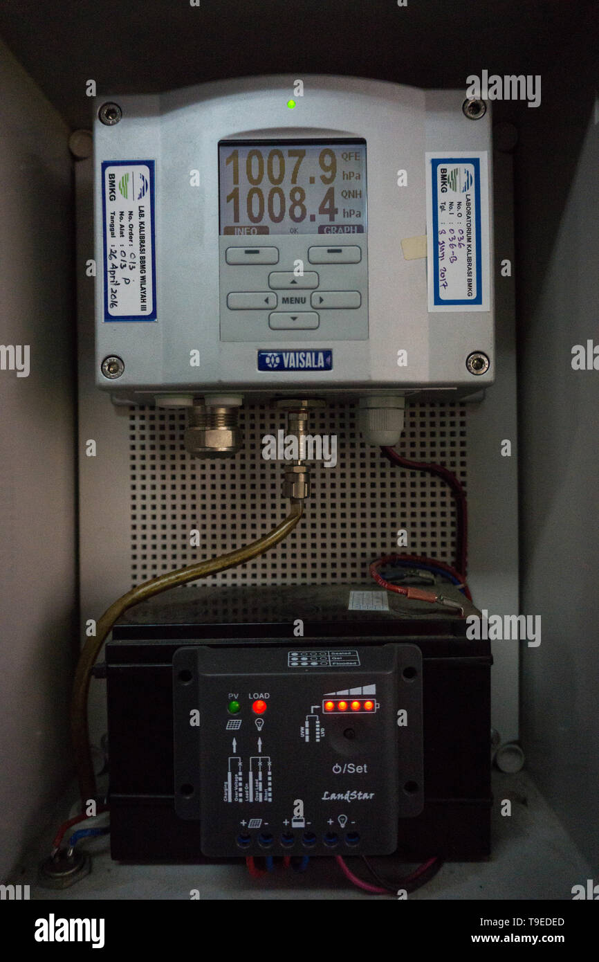 BADUNG,BALI-OCTOBER 16 2017: an air pressure gauge or a Vaisala branded altimeter is mounted walled in good working condition - Stock Image