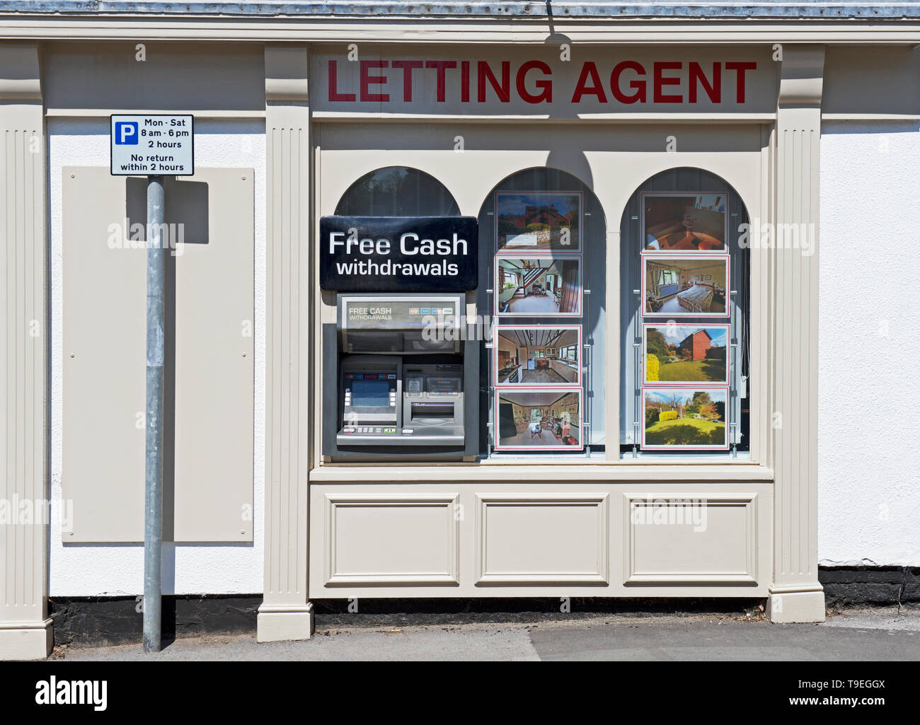 Cash machine in window of letting agent, Epworth,North Lincolnshire, England UK - Stock Image