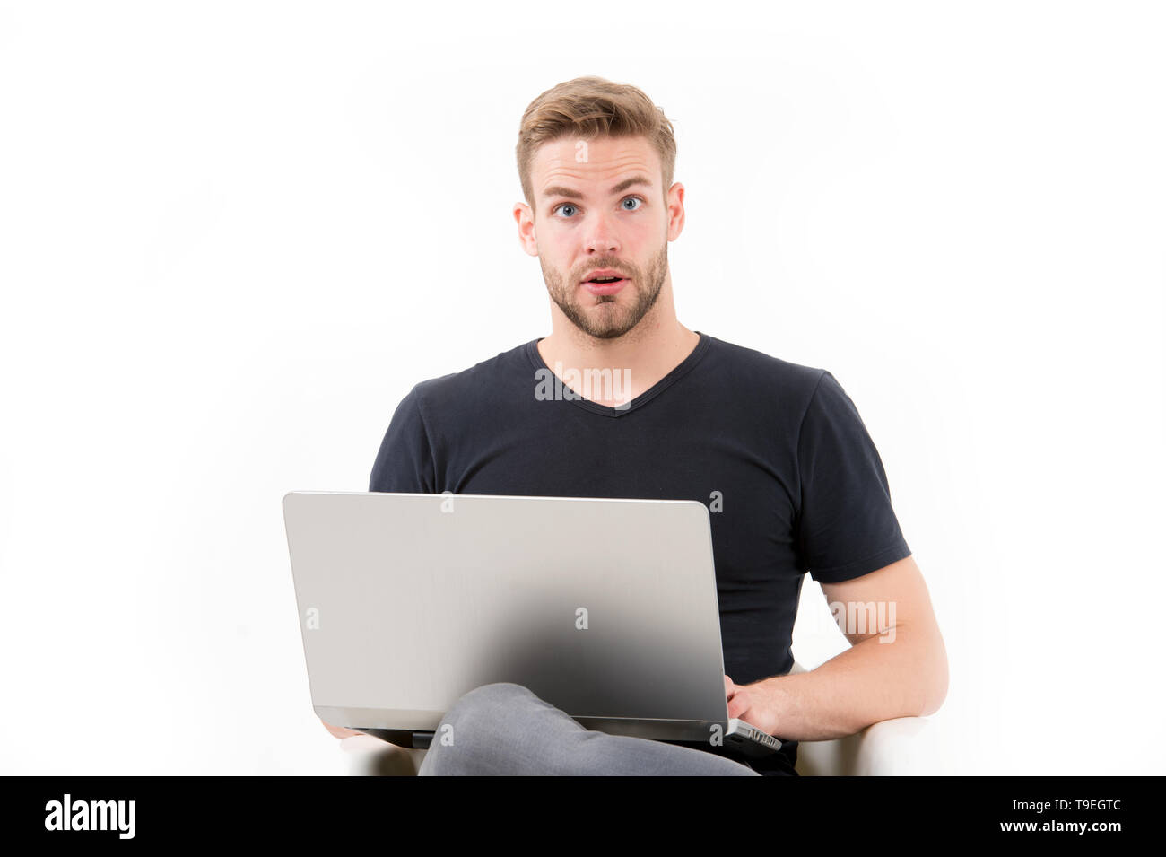 In search of inspiration. Man with laptop surprised inspired face found idea. Guy handsome unshaven in black shirt works computer isolated white. Man  - Stock Image
