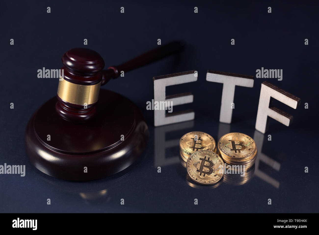 Bitcoin coins with ETF text and gavel put on dark background, Concept of the approval of Exchange Traded Fund. Stock Photo