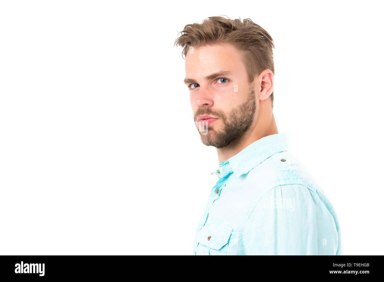 Metrosexual concept. Man bristle serious strict face looks back, isolated white. Man beard unshaven guy looks handsome and cool. Handsome in style. Gu - Stock Image