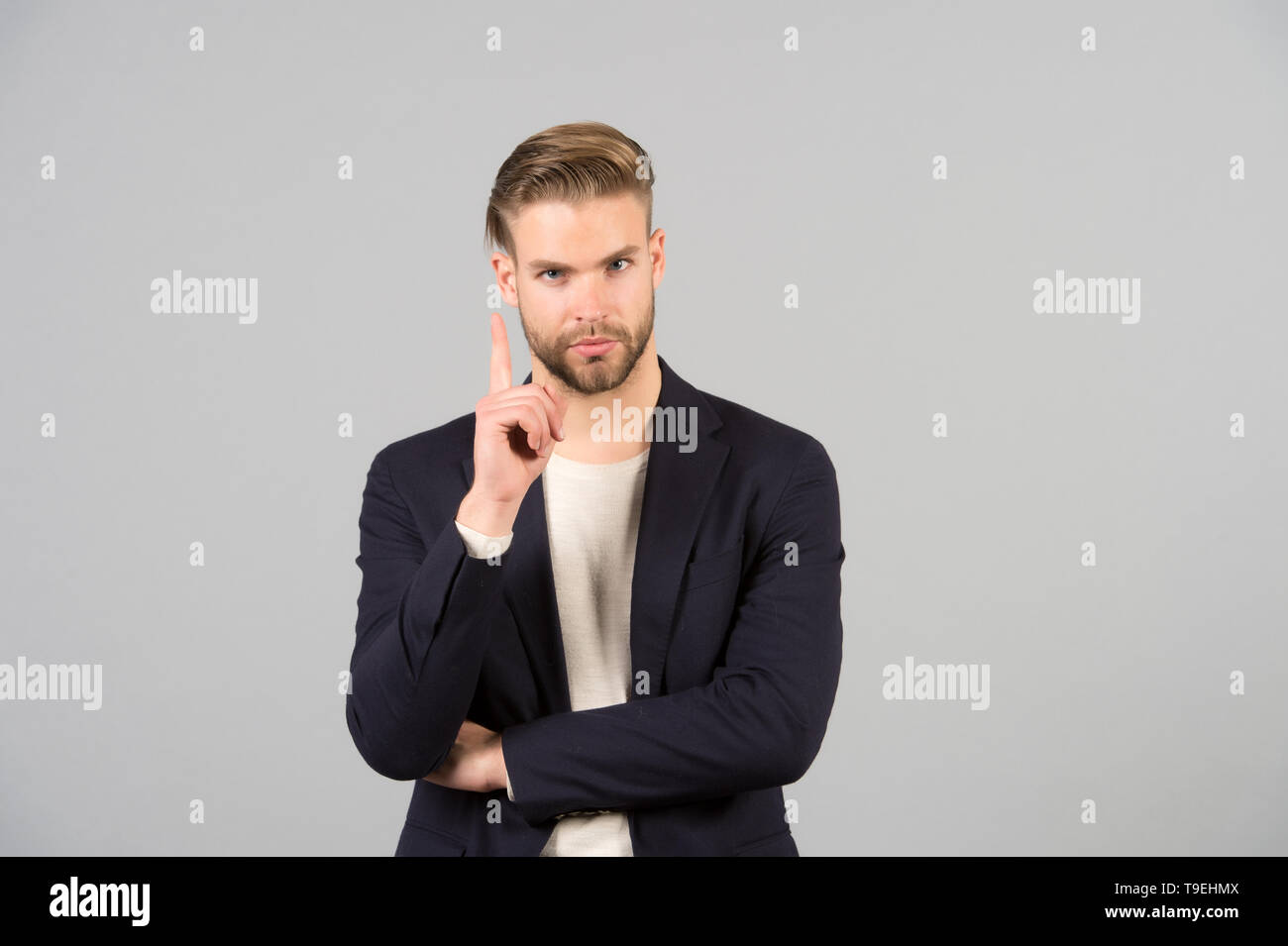 Guy bearded attractive shows warning gesture. Attention concept. Man with beard unshaven guy looks handsome well groomed formal wear. Businessman bear - Stock Image