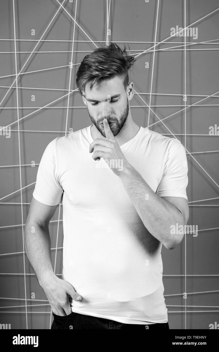 Guy bearded attractive shows silence gesture. Secret concept. Man with beard unshaven guy looks handsome well groomed and dreamy. Man with bristle str - Stock Image