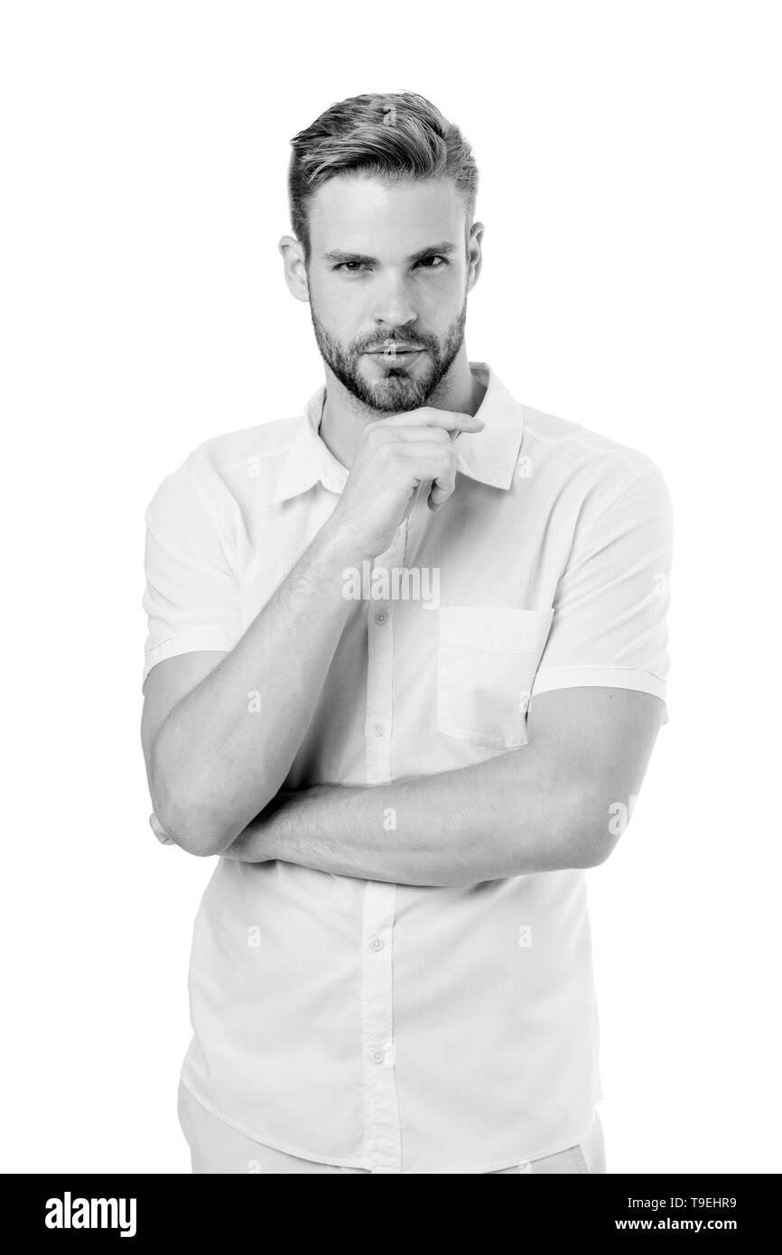 Let me think. Man with bristle serious face, white background. Guy bearded thoughtful touches bristle on chin. Thoughtful mood concept. Man with beard - Stock Image