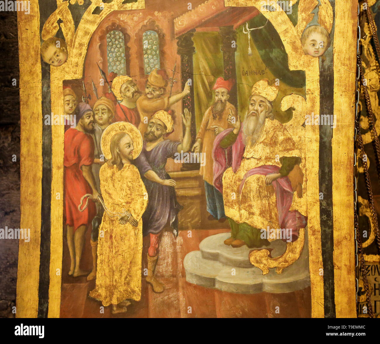 Greek Orthodox Fresco in the Church of the Holy Sepulchre in Jerusalem, depicting Jesus about to be struck in front of former High Priest Annas, as in - Stock Image