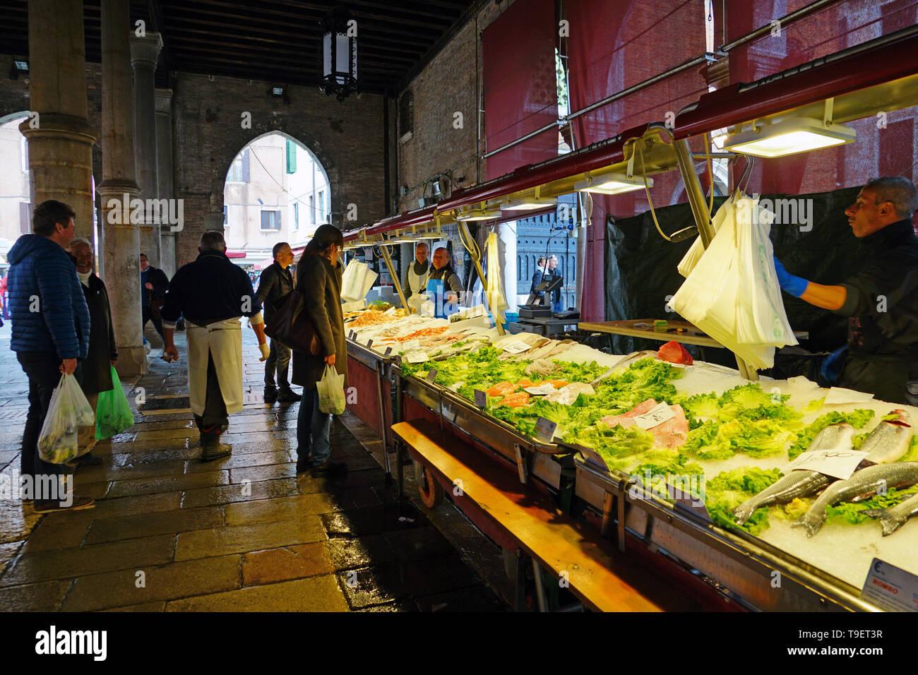 VENICE, ITALY -8 APR 2019- Fresh seafood for sale at the Rialto farmers market (Mercato di Rialto) in Venice, near the Rialto Bridge and the Grand Can - Stock Image