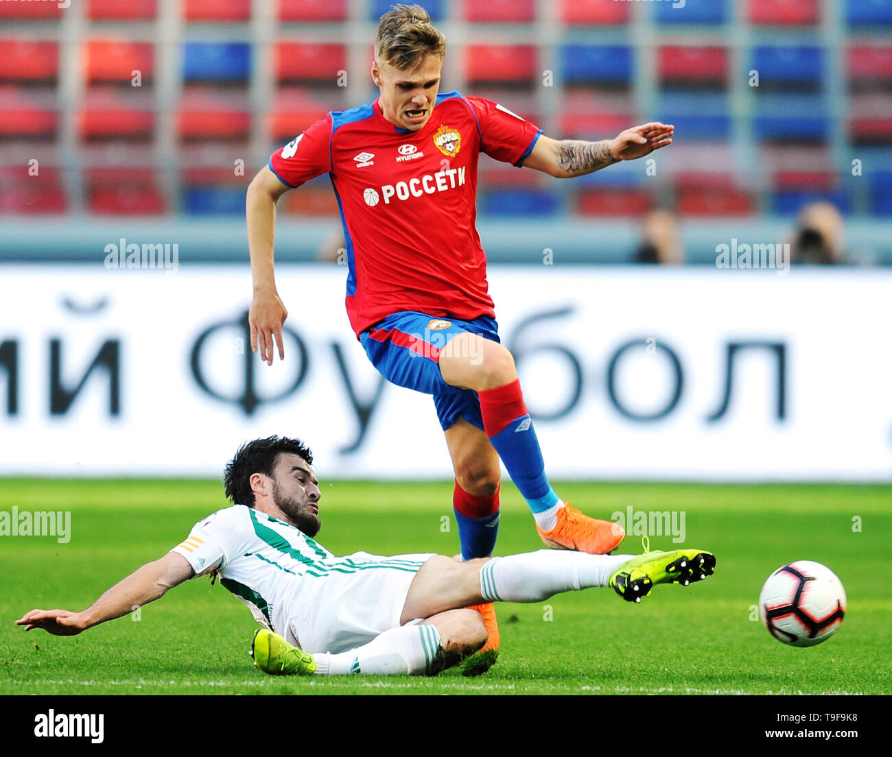 Moscow, Russia. 18th May, 2019. MOSCOW, RUSSIA - MAY 18: Arnor Sigurdsson of PFC CSKA Moscow and Rizvan Utsiyev of FC Akhmat Grozny vie for the ball during the Russian Football League match between PFC CSKA Moscow and FC Akhmat Grozny at Arena CSKA stadium on May 18, 2019 in Moscow, Russia. (Photo by Epsilon/Getty Images) Credit: ITAR-TASS News Agency/Alamy Live News - Stock Image