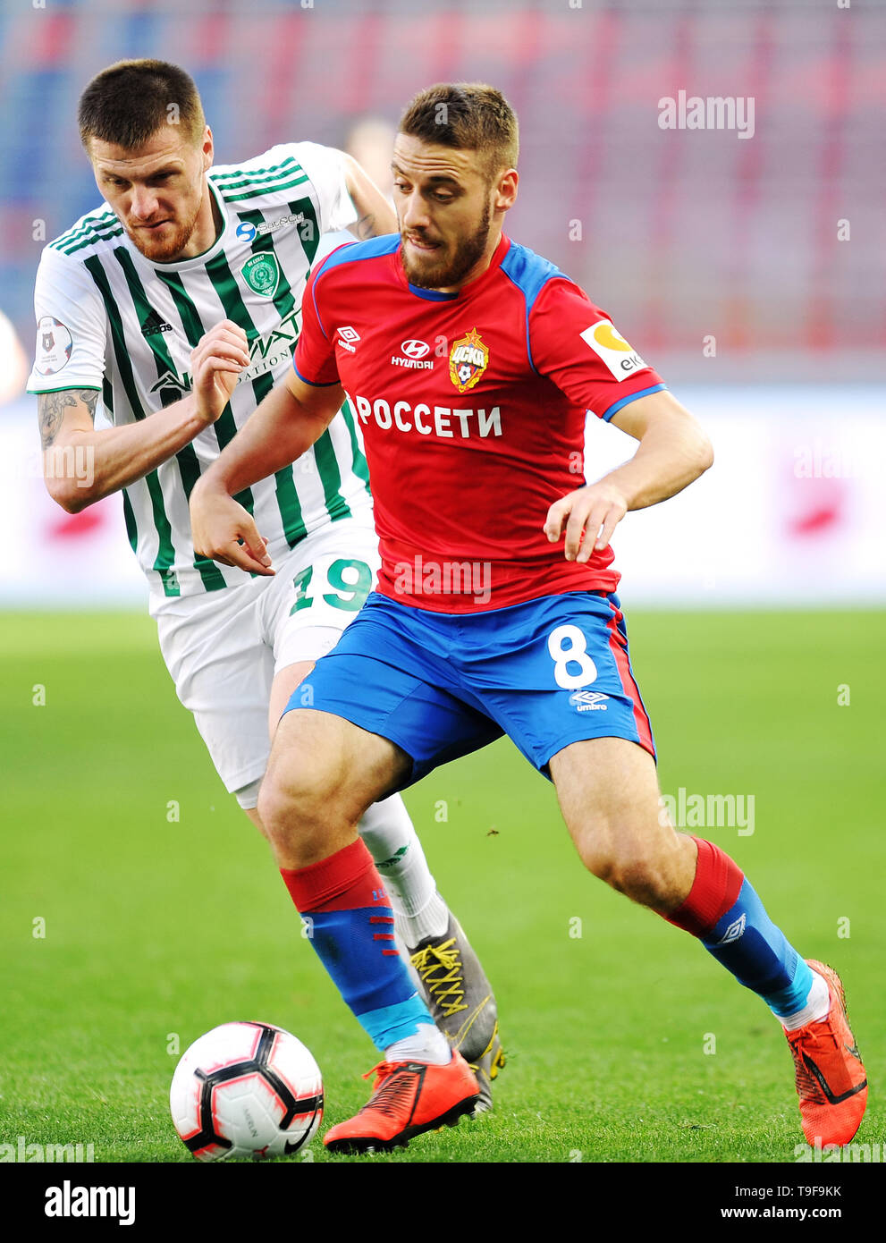 Moscow, Russia. 18th May, 2019. MOSCOW, RUSSIA - MAY 18: Nikola Vlasic of PFC CSKA Moscow and Oleg Ivanov of FC Akhmat Grozny vie for the ball during the Russian Football League match between PFC CSKA Moscow and FC Akhmat Grozny at Arena CSKA stadium on May 18, 2019 in Moscow, Russia. (Photo by Epsilon/Getty Images) Credit: ITAR-TASS News Agency/Alamy Live News - Stock Image