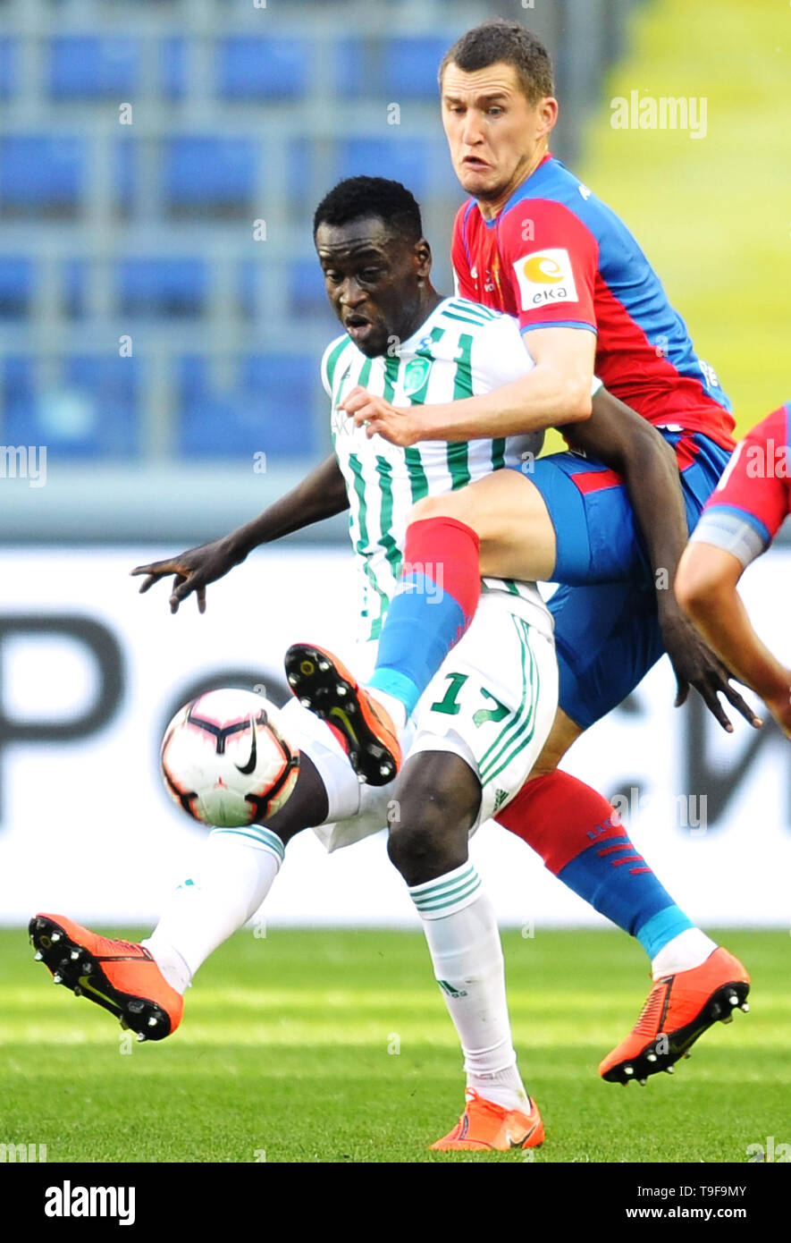 Moscow, Russia. 18th May, 2019. MOSCOW, RUSSIA - MAY 18: Viktor Vasin of PFC CSKA Moscow and Ablaye Mbengue of FC Akhmat Grozny vie for the ball during the Russian Football League match between PFC CSKA Moscow and FC Akhmat Grozny at Arena CSKA stadium on May 18, 2019 in Moscow, Russia. (Photo by Epsilon/Getty Images) Credit: ITAR-TASS News Agency/Alamy Live News - Stock Image