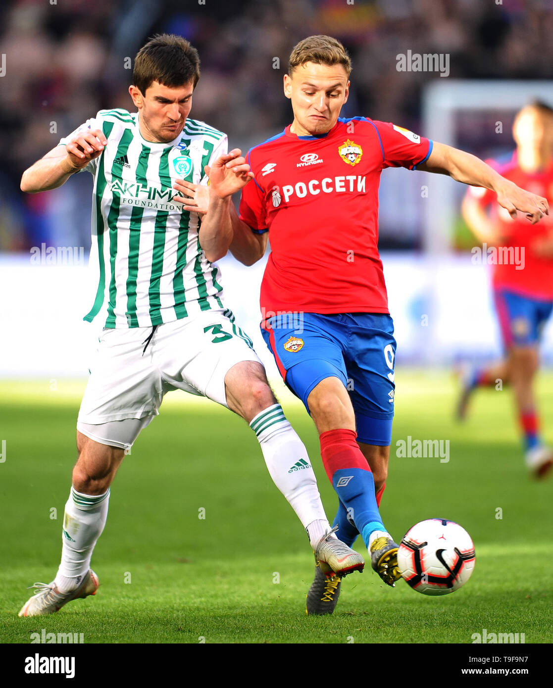 Moscow, Russia. 18th May, 2019. MOSCOW, RUSSIA - MAY 18: Fyodor Chalov of PFC CSKA Moscow and Zaurbek Pliyev of FC Akhmat Grozny vie for the ball during the Russian Football League match between PFC CSKA Moscow and FC Akhmat Grozny at Arena CSKA stadium on May 18, 2019 in Moscow, Russia. (Photo by Epsilon/Getty Images) Credit: ITAR-TASS News Agency/Alamy Live News - Stock Image