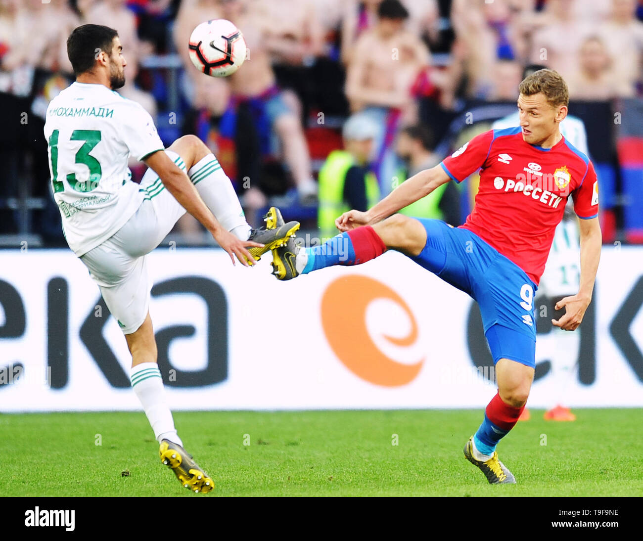 Moscow, Russia. 18th May, 2019. MOSCOW, RUSSIA - MAY 18: Fyodor Chalov of PFC CSKA Moscow and Milad Mohammadi of FC Akhmat Grozny vie for the ball during the Russian Football League match between PFC CSKA Moscow and FC Akhmat Grozny at Arena CSKA stadium on May 18, 2019 in Moscow, Russia. (Photo by Epsilon/Getty Images) Credit: ITAR-TASS News Agency/Alamy Live News - Stock Image