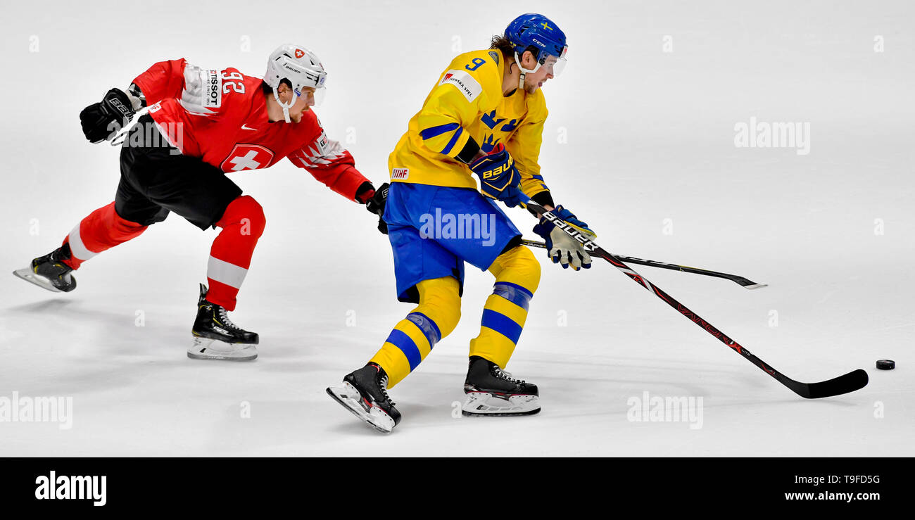 Bratislava, Slovakia. 18th May, 2019. From left hockey player GAETAN HAAS of Switzerland and ADRIAN KEMPE of Sweden in action during the match Sweden against Switzerland within the 2019 IIHF World Championship in Bratislava, Slovakia, on May 18, 2019. Credit: Vit Simanek/CTK Photo/Alamy Live News - Stock Image