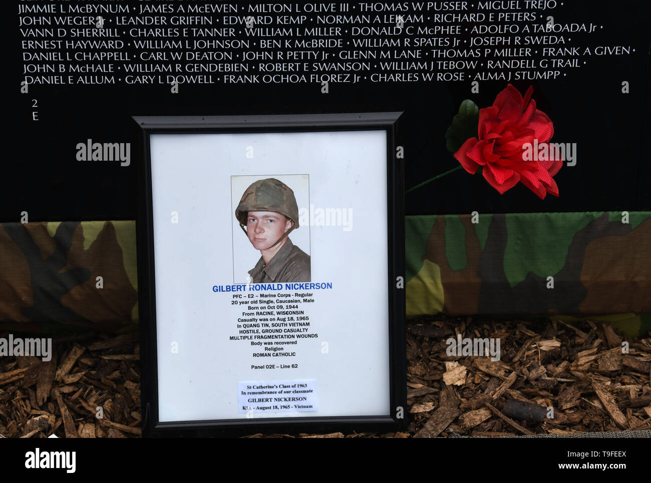 Racine, Wisconsin, USA. 18th May, 2019. Gilbert Ronald Nickerson, the first Racine soldier killed in Vietnam, is honored at the Moving Wall, a half-size replica of the Vietnam Veterans Memorial, in Racine, Wisconsin, Saturday May 18, 2019. He died August 18, 1965. Forty-seven soldiers from Racine were killed during the war. The Moving Wall has been touring the United States for more than 30 years. Credit: Mark Hertzberg/ZUMA Wire/Alamy Live News - Stock Image