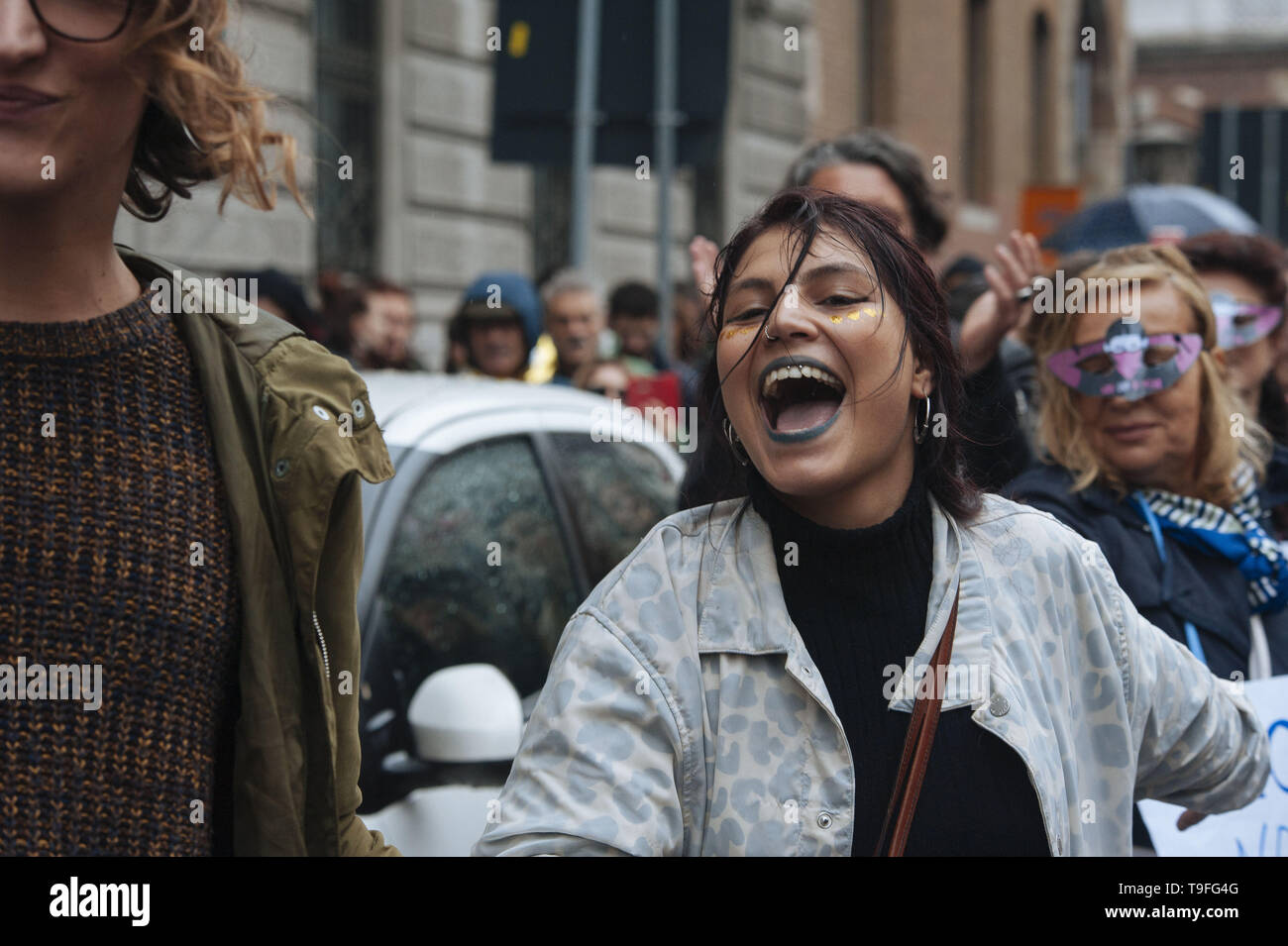 Milano, Lombardia, Italy. 18th May, 2019. A woman seen shouting during the protest.The feminist movement Non Una di Meno, together with other Italian associations, protested against the European election's closing meeting with Matteo Salvini, leader of the Populist Party the League and Italian Ministry of Interior and Vice Premier and Marine Le Pen and the uprising of fascism, far right, xenophobia and extremism in Europe. Credit: Valeria Ferraro/SOPA Images/ZUMA Wire/Alamy Live News - Stock Image