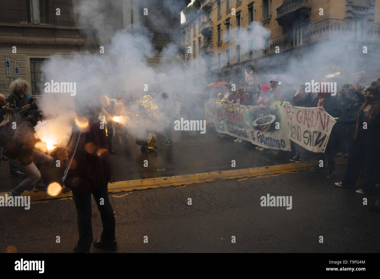 Milano, Lombardia, Italy. 18th May, 2019. A woman seen burning flares during the protest.The feminist movement Non Una di Meno, together with other Italian associations, protested against the European election's closing meeting with Matteo Salvini, leader of the Populist Party the League and Italian Ministry of Interior and Vice Premier and Marine Le Pen and the uprising of fascism, far right, xenophobia and extremism in Europe. Credit: Valeria Ferraro/SOPA Images/ZUMA Wire/Alamy Live News - Stock Image