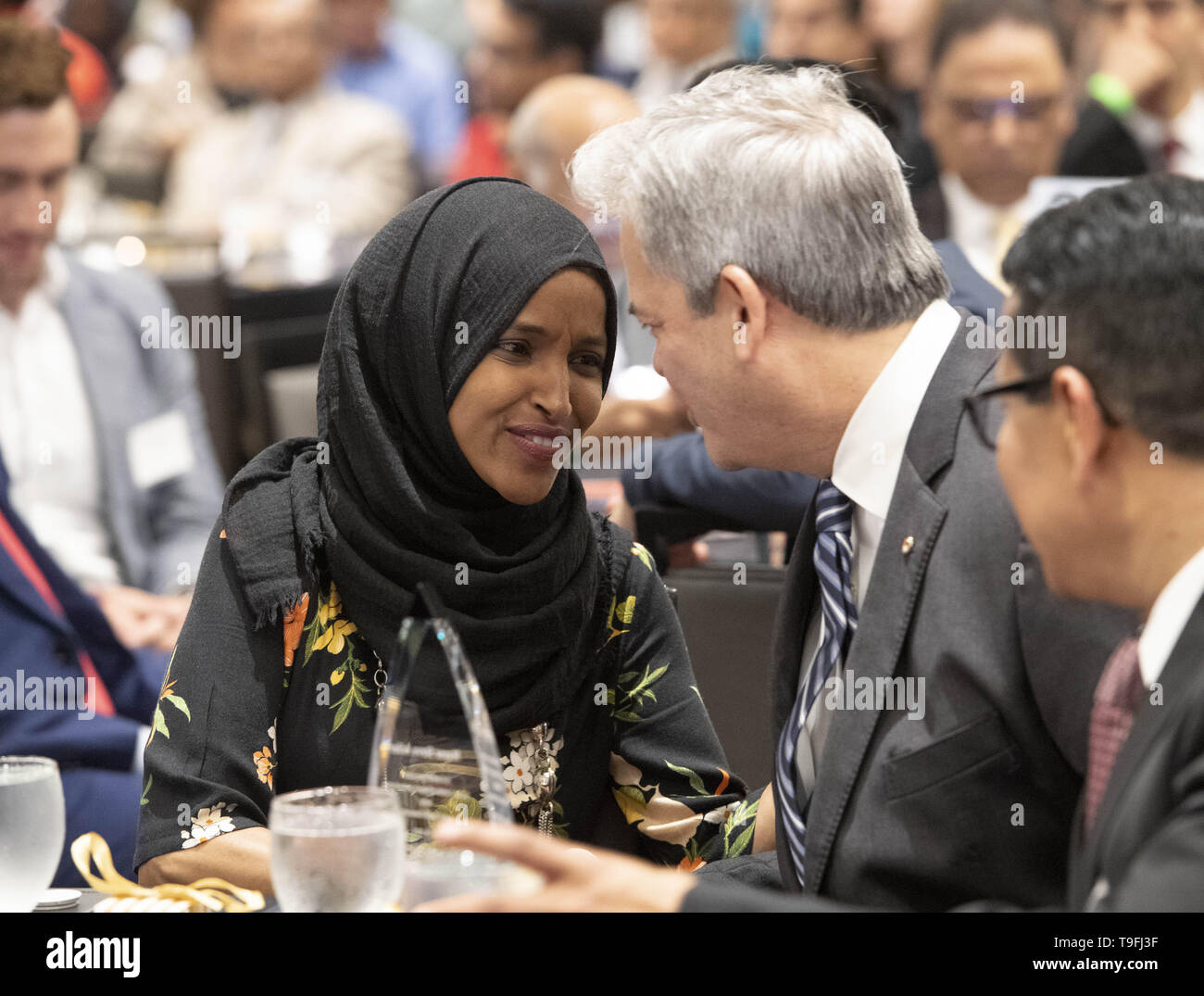 Texas, USA. 18th May, 2019. Congresswoman Ilhan Omar of Minnesota's 5th Congressional District thanks Mayor Steve Adler Austin's annual city-wide iftar dinner in honor of the 14th day of Ramadan. Omar was joined by Adler, a Jew, to call for peace and harmony in today's divisive climate. Credit: ZUMA Press, Inc./Alamy Live News - Stock Image