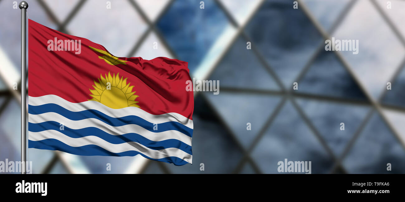 Kiribati flag waving in the wind against blurred modern building. Business concept. National cooperation theme. - Stock Image