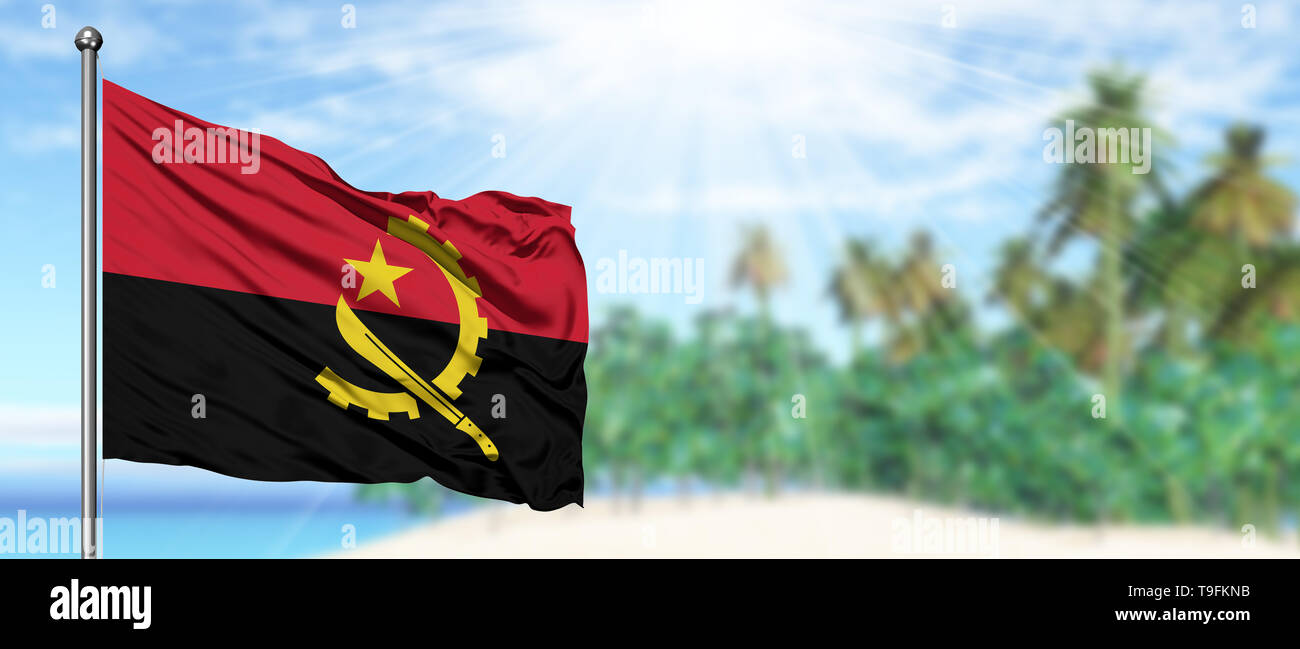 Waving Angola flag in the sunny blue sky with summer beach background. Vacation theme, holiday concept. - Stock Image