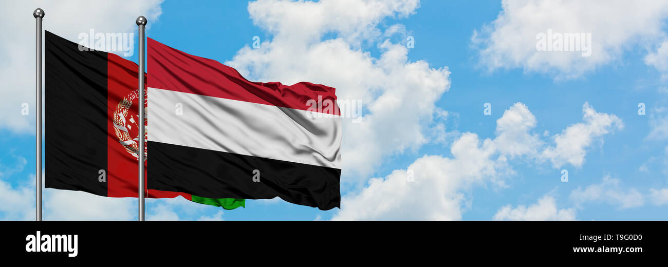 Afghanistan and Yemen flag waving in the wind against white cloudy blue sky together. Diplomacy concept, international relations. - Stock Image