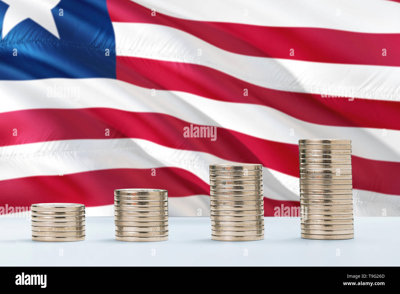Liberia flag waving in the background with rows of coins for