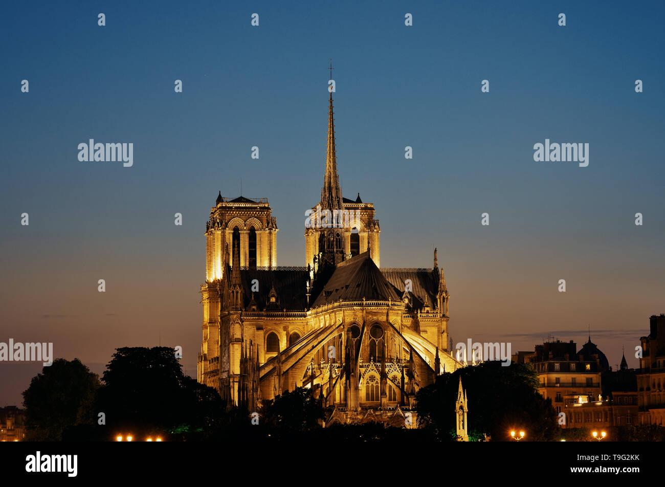 Notre Dame de Paris at dusk as the famous city landmark. - Stock Image