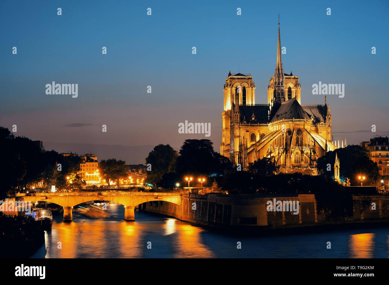 Notre Dame de Paris at dusk over River Seine as the famous city landmark. - Stock Image