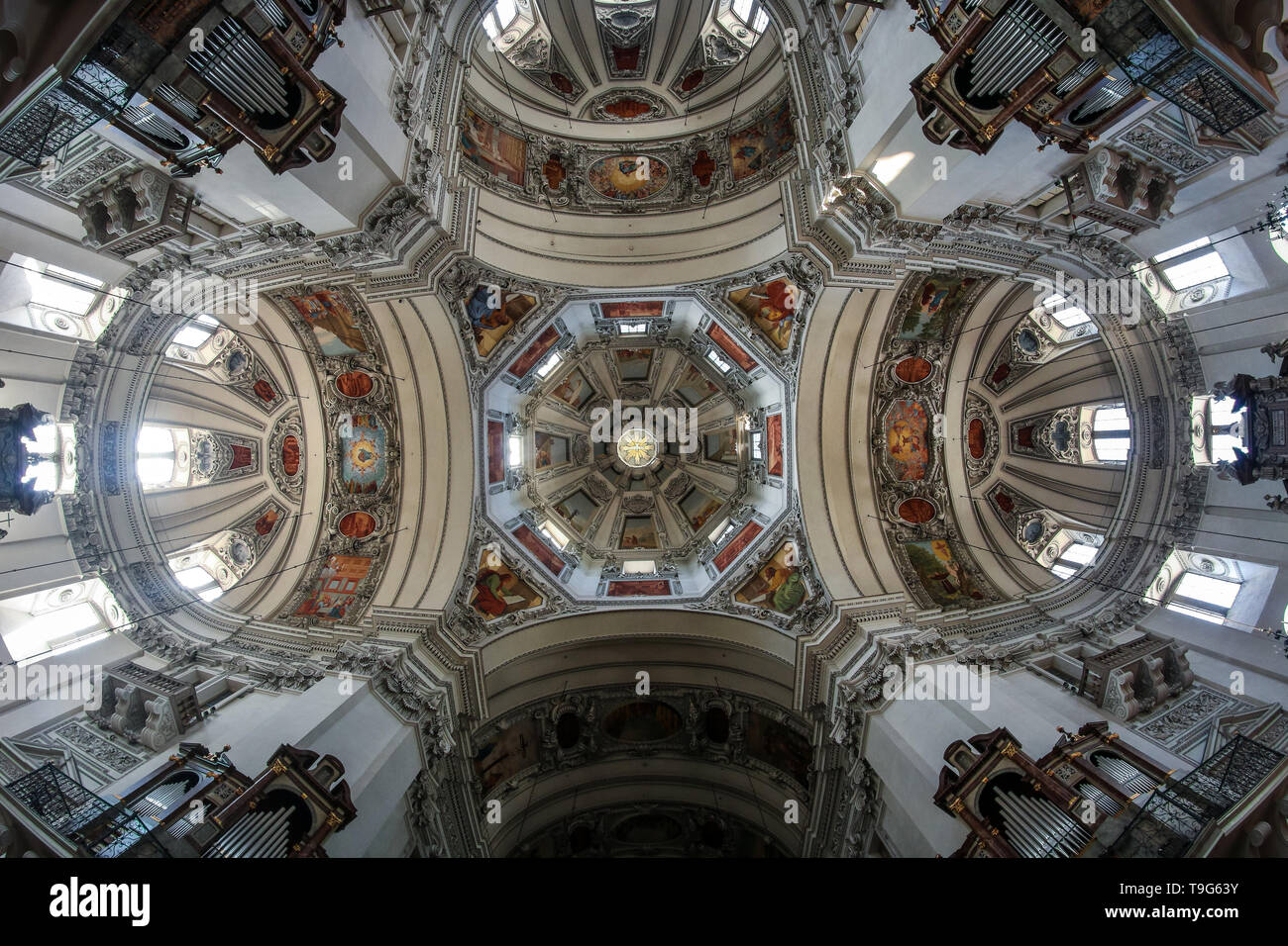 The nice paintings on the ceiling in the interior of the cathedral in Salzburg in Austria. Stock Photo