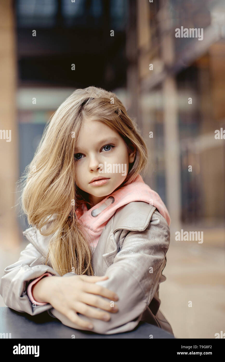 Very Beautiful Little Girl With Long Blonde Hair And Blue Eyes