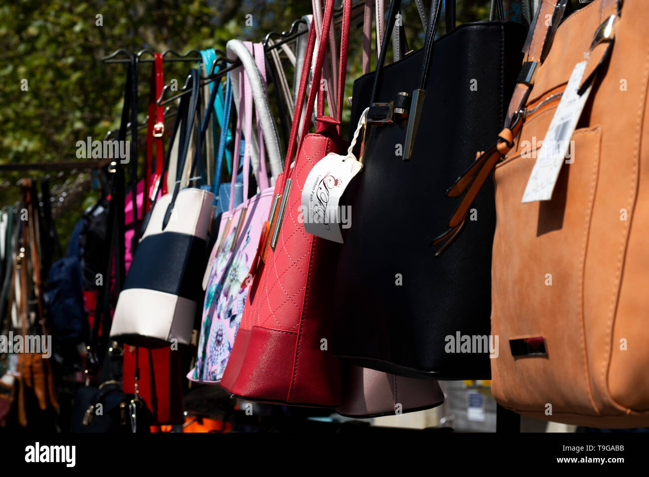 918853c0 Leather ladies handbags for sell on market stall Stock Photo ...